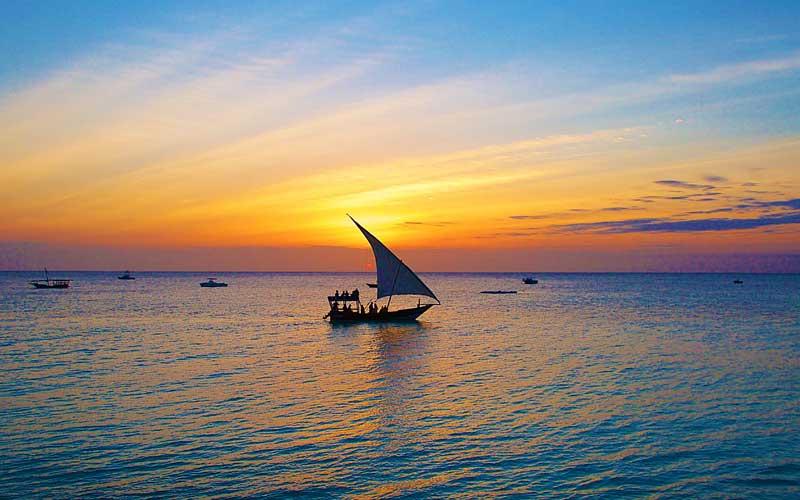 Dhow-boat-sailing-sunset-Zanzibar